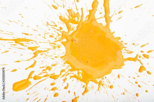 Fotografia, Obraz Orange paint spots on paper, colorfull artistic image on white background
