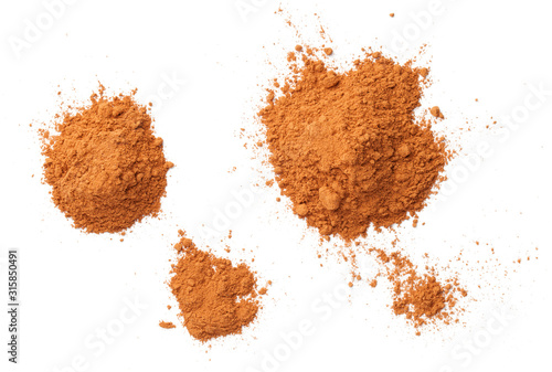 Cuadros en Lienzo Cinnamon Powder Piles Isolated On White Background