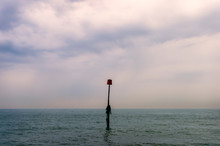 Sea Scape Sunset With Buoy