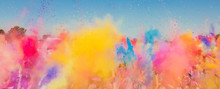 Crowd Throwing Bright Colored Powder Paint In The Air At Holi Festival Dahan