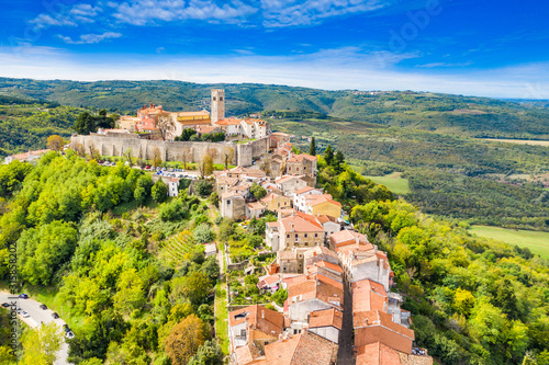 Beautiful old town of Motovun, stone houses and church tower bell, romantic architecture in Istria, Croatia, aerial view from drone