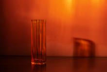 Empty Glass Orange Vase On An Orange Background