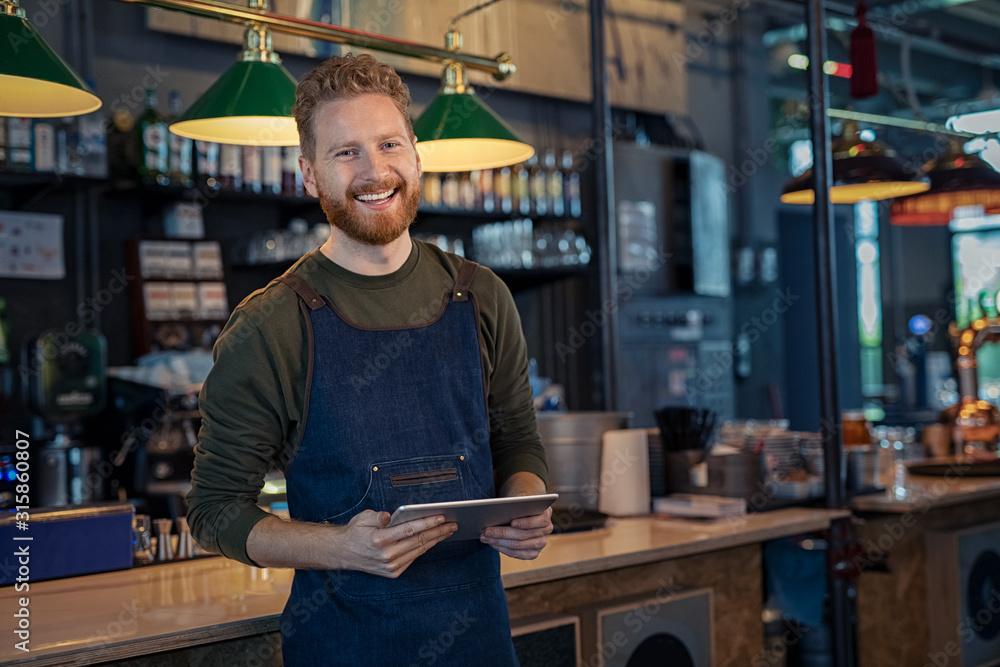 Fototapeta Smiling Waiter ready to take order at pub