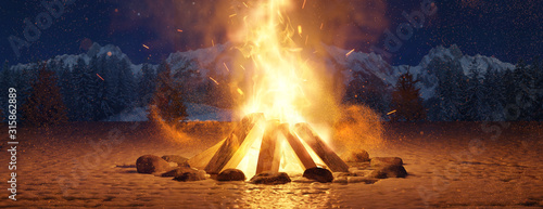Obraz na plátně Glühendes Lagerfeuer im Schnee bei Nacht auf offenem Feld