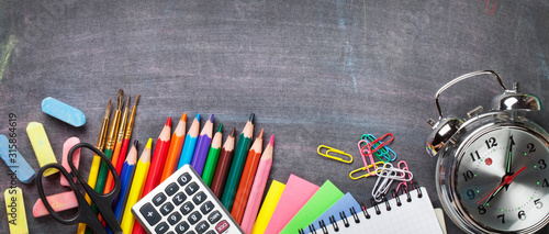 Obraz School supplies on blackboard background - fototapety do salonu