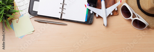 Fototapeta Business trip concept. Accessories on desk table obraz