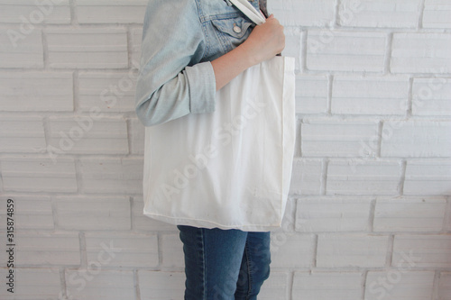 Fototapety, obrazy: Woman holding cotton grocery bag. eco bag for shopping. Zero waste concept