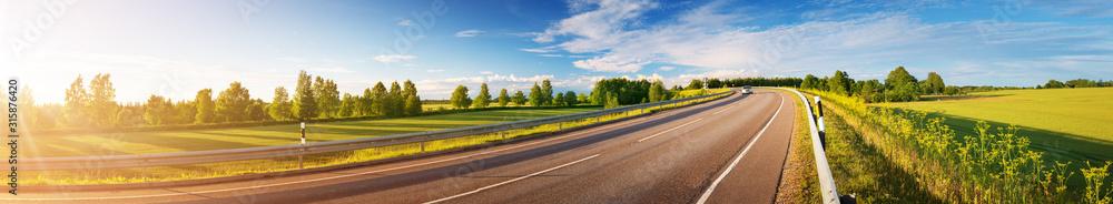 Fototapeta asphalt road panorama in countryside on sunny summer day