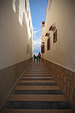 Fototapeta Uliczki - Narrow street between houses on the beach