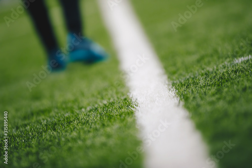 Sports grass field pitch and white sideline Canvas Print