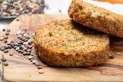 Obraz Tasty vegetarian lentils burgers, healthy food - fototapety do salonu