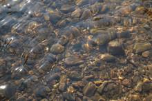 Pebble Stone Under Water Closeup