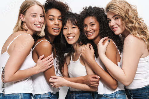Photo Image of pretty multinational women smiling and hugging together