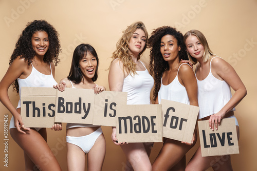 Fototapety, obrazy: Image of seductive multinational women smiling and holding placards