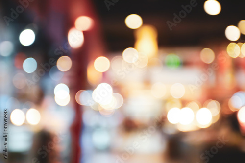 Obraz abstract blur bokeh light background in shopping mall - fototapety do salonu