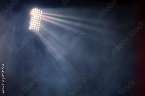Obraz stadium lights and smoke against dark night sky background - fototapety do salonu
