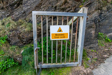 A Steep Slope Warning Sign On ...
