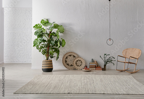 Photo Grey stone wall, white brick background, interior style, chair lamp and object