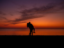 Silhouette Young Couple In Lov...