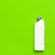 Leinwandbild Motiv White plastic bottle for liquid detergent, cleaning agent, bleach, antibacterial gel with natural plant extract and green leaves on green background. Eco style cleaning concept. Flat lay top view