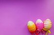canvas print picture - decorative Easter eggs on purple background