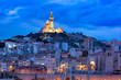 Leinwanddruck Bild - Panoramic view of night Old Port and the Basilica of Notre Dame de la Garde on the background, on the hill, Marseille, France