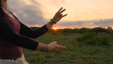 Fototapeta Sport - Happy female dance in the summer fields during beautiful sunset