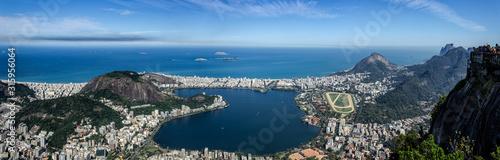 Fotografie, Tablou  Panorama View of the Rio de Janeiro City, including the Laggon (Lagoa Rodrigo de Freitas), seen from the Corcovado Mountain