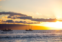Sail Boats On The Ocean At Sun...