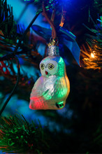 White Ceramic Owl Hanging On A...