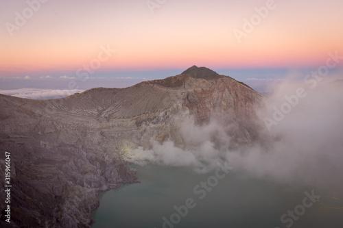 Stunning sunrise or sunset on Ijen Crater Wallpaper Mural