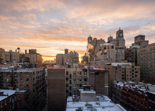 Snowy Rooftops At Sunset On Th...