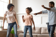 Happy Black Family Dancing In ...