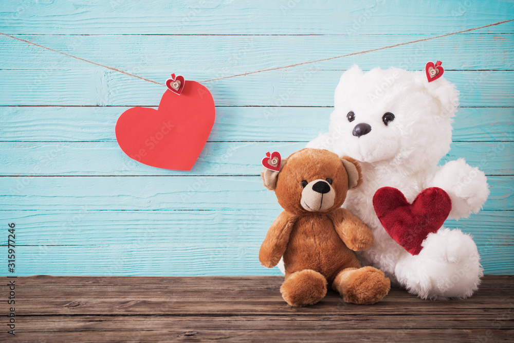 Fototapeta Teddy bear with red heart on old wooden background. Valentine's