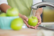 Womans Hands Rinsing Green App...