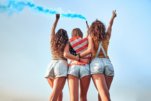 Group Of Girls With American F...