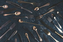 Old Cutlery On A Dark Concrete...