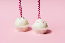 Colorful Cake Pops On A Pink B...