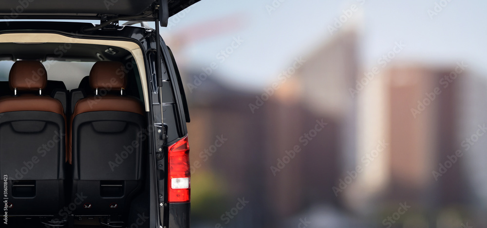Fototapeta minibus vip transfer service of first class on background business district