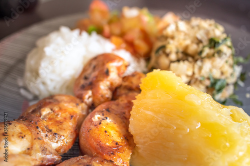 Chicken full meal with bacon, rice, cooked cassava, tropeiro beans and vinaigrette Fototapeta