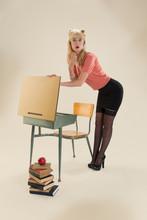 Surprised Pin-up Girl Looking In School Desk