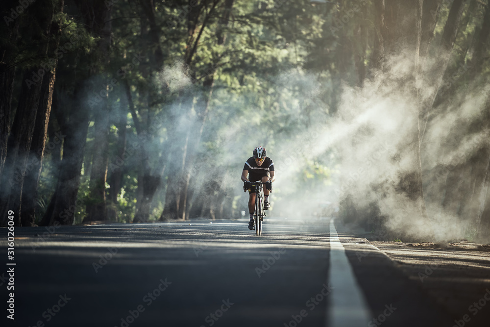Fototapeta Asian men are cycling road bike in the morning