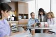 Doctors using digital tablet in break room