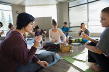 Women Comparing Essential Oils At Yoga Retreat