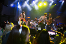 Music Band Performing On Stage At Concert