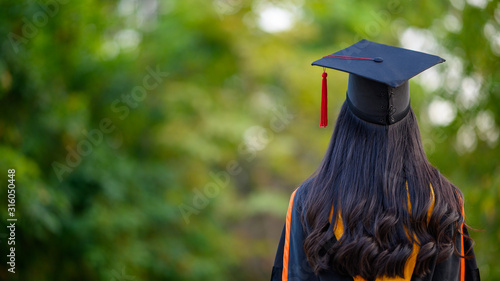 Female graduates wear black gowns and yellow tassels waiting to attend the commencement ceremony at the university Canvas Print