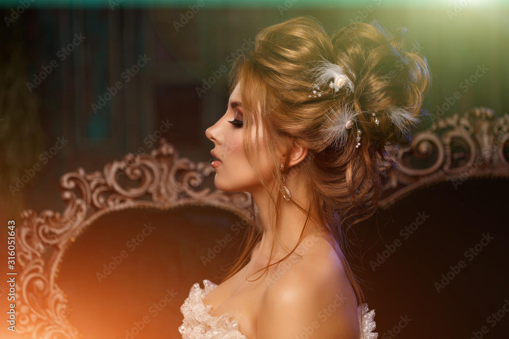 Fototapeta Luxury model in vintage style. Beautiful woman with a stunning hairstyle and make-up in a rococo dress. Girl at the Masquerade Spring Ball