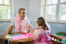 Daughter And Father Having A Princess Party