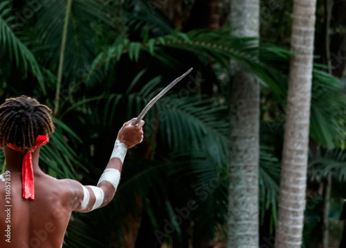 Australian Aborigine culture traditional dance with body paint and hand holding Wallpaper Mural
