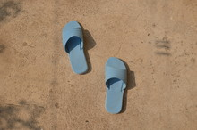 Blue Pair Of Shoes Placed On The Concrete Floor